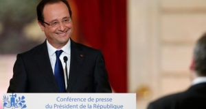 French president François Hollande replies to questions after his speech at the Élysée Palace yesterday. Photograph: Benoit Tessier/Reuters