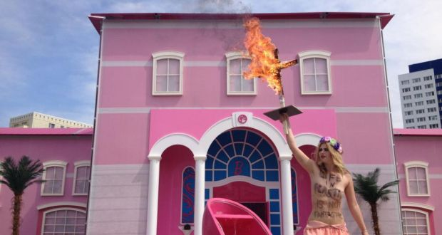A Woman Protests At Berlin S Barbie Dreamhouse Life In Plastic Is Not