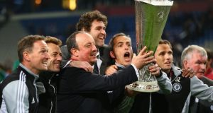 Chelsea interim manager Rafael Benitez and his coaching staff pose with the Europa League  trophy after victory over Benfica in Amsterdam. Photograph:  Michael Steele/Getty Images