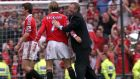 Manchester United manager Alex Ferguson (right) congratulates David Beckham (centre) and Roy Keane after his side clinched the Premiership title at Old Trafford in 1999. Beckham has announced his intention to retire at the end of the season. The former England captain (38) will call it a day after winning the French league title with Paris St Germain.  Photograph: Phil Noble/PA Wire.