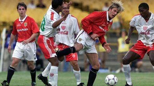 David Beckham and Necaxa's Jose Milian in a challenge which saw the Manchester Utd player sent off during their World Club Championship match at the Maracana Stadium, Rio de Janeiro in 2000. Photograph: Phil Noble/PA Wire