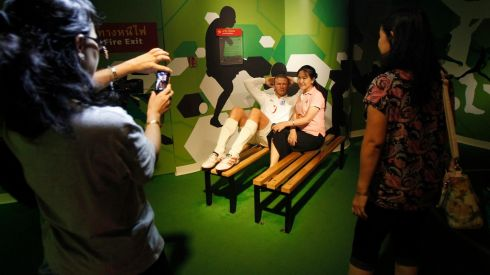 A woman poses with a wax figure of David Beckham at Madame Tussauds Wax Museum in Bangkok. Photograph: Chaiwat Subprasom/Reuters