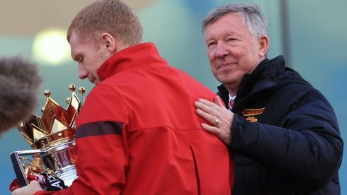 Manchester United manager Sir Alex Ferguson pats Paul Scholes on the back at the start of their Barclays Premier League Trophy Parade through Manchester. Scholes has announced his retirement from football at the end of the 2013 season.  Photograph: Christopher Furlong/Getty Images