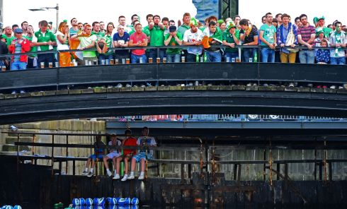 Fans cheer on the Republic of Ireland, while watching the match on a large screen, at Three on the Quay, a festival of football, at George's Dock, Dublin. Photograph: Eric Luke