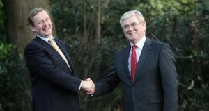 Grip and grin: Enda Kenny with Eamon Gilmore. Photograph: Alan Betson/The Irish Times