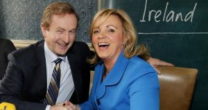 Grip and grin: Enda Kenny with Louise Phelan of PayPal at a job announcement. Photograph: Julien Behal/PA