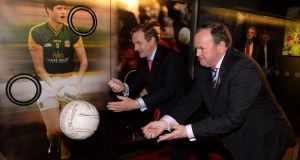An Taoiseach Enda Kenny trys his skill against GAA President Liam O Neill at the Official opening of the GAA Museum in Croke Park yesterday. Photograph: David Sleator/The Irish Times