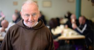 "Brother Kevin at breakfast in the Capuchin Day Centre, Bow Street, Dublin. ""I saw this woman coming up to collect food in a car and I said, 'Is there a need for you to be coming here when you have a car?' It turned out her husband was after beating her up and throwing her out. She was living in the car. It was her home... Nobody would queue up here for food unless they needed to."" Photographer: Dara Mac Dónaill"