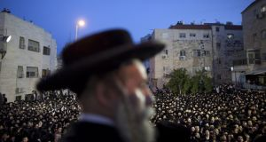Ultra-Orthodox demonstrators pack the streets in Jerusalem to protest against government plans to force students at yeshiva religious seminaries to enlist in the Israeli army. Photograph: Uriel Sinai/Getty Images