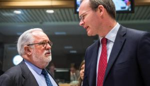 Spain's Agriculture Minister Miguel Arias Canete (left) talks Simon Coveney at the start of an EU Agriculture and Fisheries Council at the EU Council in Brussels on Monday. Photograph: Geert Vanden Wijngaert/AP