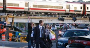 Passengers wait to be picked up by bus after two commuter trains collided in Bridgeport, Connecticut, causing one to derail. Photograph: Michelle McLoughlin Reuters