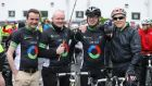Shane Finnegan, deputy First Minister Martin McGuinness, Joe Brolly and   First Minister Peter Robinson at the start of the Life Cycle Challenge  in Belfast today. Photograph: PA Wire