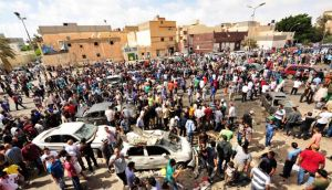 People gather at the scene of a car bomb explosion outside a hospital in Benghazi, where three people were killed on Monday. Photograph: Esam Al-Fetori/Reuters
