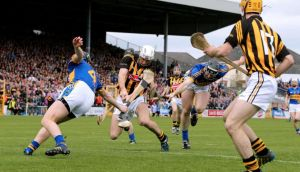 Kilkenny's Michael Fennelly (centre) scores the opening goal against Tipperary in the league final at Nowlan Park.  Photograph: Cathal Noonan/Inpho