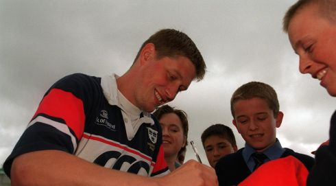 Fresh faces: The emerging hero signs autographs for young Munster fans in 2000.  Photograph: Andrew Paton/Inpho