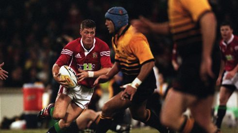 Show and go: O'Gara ducks behind the Western Australia cover when playing for the British and Irish Lions  in 2001.  Photograph: Billy Stickland/Inpho