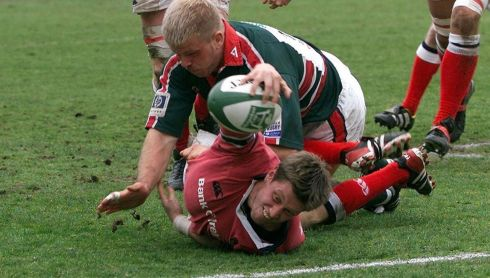 O'Gara reaches for the line to score Munster's first try against Leicester during their Heineken Cup quarter-final at Welford Road in 2003. Photograph: David Davies/PA