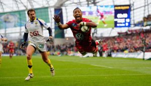 Toulon's  Delon Armitage dives in for the decisive try after outrunning  Brock James of Clermont Auvergne in the Heineken Cup final  at the Aviva Stadium in Dublin. Photograph: Stu Forster/Getty Images