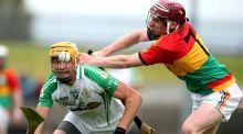 Martin Duggan of London evades  James O'Hara of Carlow at Dr Cullen Park. Photograph: Donall Farmer/Inpho