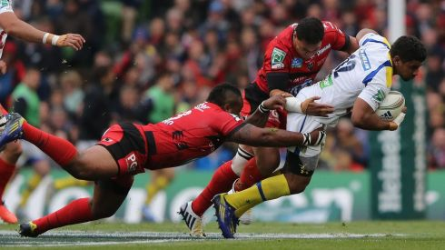 Wesley Fofana of ASM Clermont Auvergne is tackled by Mathieu Bastareaud and Chris Masoe of Toulonduring the Heineken Cup final match. Photograph: Ian Walton/Getty Images