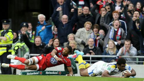 Clermont's Naipolioni Nalaga scores the opening try despite Delon Armitage of Toulon. Photograph: James Crombie/Inpho