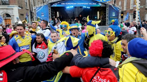 Clermont and Toulon fans enjoy the atmosphere at the ERC Champions Village. Photograph: James Crombie/Inpho