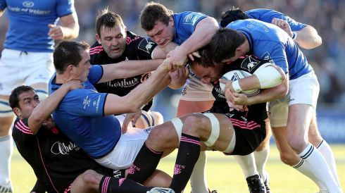 Leinster's Devin Toner, Jack McGrath and Johnny Sexton wrap up Sergio Parisse of Stade Francais Paris. Photograph: Dan Sheridan/Inpho