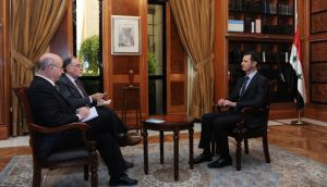 Syria's president Dr Bashar al-Assad (right) sits during an interview with journalists from Argentina in Damascus in this handout photograph distributed by Syria's national news agency Sana. Photograph: Reuters/Sana