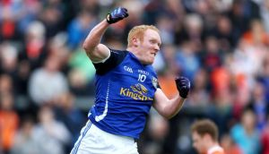 Cavan's Cian Mackey celebrates his first half goal against Armagh at Breffnis Park. Photograph: Ryan Byrne/Inpho