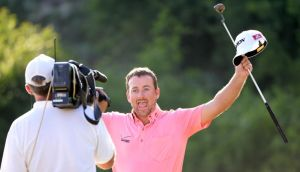 Graeme McDowell of Northern Ireland celebrates after beating Thongchai Jaidee 2&1 in the final of the Volvo World Match Play Championship at Thracian Cliffs Golf & Beach Resort in Kavarna, Bulgaria. Photograph:  Ross Kinnaird/Getty Images