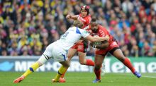 Mathieu Bastareaud of RC Toulon is tackled by Aurelien Rougerie of ASM Clermont Auvergne during the Heineken Cup Final between ASM Clermont Auvergne and RC Toulon at the Aviva Stadium, Dublin. Photo:  Rob Munro
