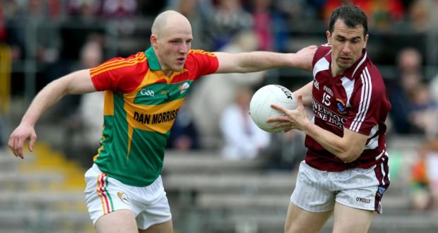 Westmeath's Dessie Dolan is tackled by Shane Mernagh of Carlow at Cusack Park. Photograph Lorraine O'Sullivan/Inpho