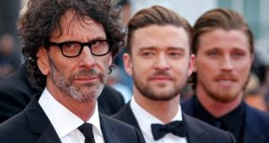 From left: director Joel Coen and actors  Justin Timberlake and Garrett Hedlund  arrive for the premiere of Inside Llewyn Davis at the Cannes Film Festival yesterday. Photograph: Reuters/Jean-Paul Pelissier
