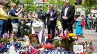 Taoiseach Enda Kenny vists a memorial in Copley Square near the finish line of the Boston Marathon to lay flowers with Boston Police Commissioner Ed Davis. Photograph: Dominick Reuter/Reuters