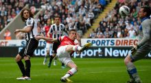 Arsenal's Lourent Koscielny scores against Newcastle United during their English Premier League  match at St James' Park. Photograph: Reuters