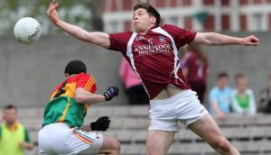 Westmeath's Callum McCormack gtes to the ball ahead of  Barry-John Molloy of Carlow in their GAA Fotball Senior Championship clash at Cusack Park. Photograph: Lorraine O'Sullivan/Inpho