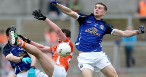 Cavan's Killian Clarke and Killian Brady contest a for a high ball with with Ethan Rafferty of Armagh during the Ulster Senior Football  Championship preliminary round at Breffini Park. Photograph:  Ryan Byrne/Inpho