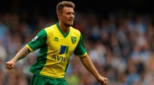 Anthony Pilkington of Norwich celebrates his goal against Manchester City at the Etihad Stadium yesterday. Photograph: Paul Thomas/Getty Images