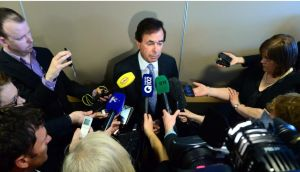 Minister for Justice Alan Shatter takes questions from the media on the Wallace controversy outside a citizenship ceremony in the Convention Centre in Dublin. Photograph: Bryan O'Brien/The Irish Times