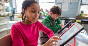 Worth the investment?: there is no benefit in leaving school highly proficient at using an iPad. Photograph: Aram Boghosian/Boston Globe via Getty