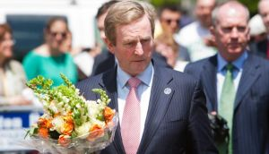 Taoiseach Enda Kenny visited a memorial in Copley Square near the finish line of the Boston Marathon to lay flowers today. Photograph: Reuters