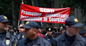 Police stand guard during the gay rights    rally in Tbilisi. Photograph: Reuters
