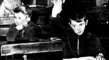 Anseo: Gearóid Ó Catham (with his hand raised) in his new classroom in Dunquin