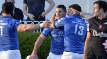 Rob Kearney is congratulated by team-mates Seán O'Brien (left) and Fergus McFadden after scoring a try against Stade Français in the Amlin Challenge Cup final last Friday. Photograph: AFP/Getty Images