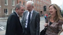 Jerry Buttimer TD speaks to perinatal psychiatrists Dr Anthony McCarthy and Dr Joanne Fenton outside Leinster House yesterday. Photograph: Gareth Chaney/Collins
