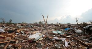 Debris covers the ground after a powerful tornado ripped through the area in Moore, Oklahoma. Photograph: Brett Deering/Getty Images