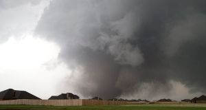 A huge tornado approaches the town of Moore, Oklahoma, near Oklahoma City, yesterday. At least 91 people are so far known to have been killed in its wake. Photograph: Richard Rowe/Reuters