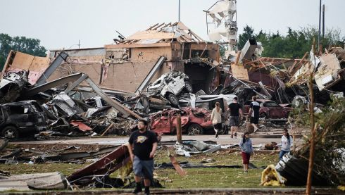 People survey the damage to a shattered way of life after the Moore tornado strike. Photograph: Gene Blevins/Reuters