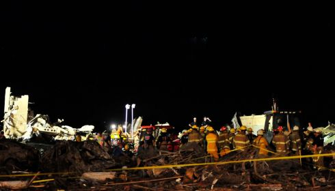 Rescuers at work overnight at the remains of Plaza Towers Elementary School. Photograph: Nick Oxford/New York Times