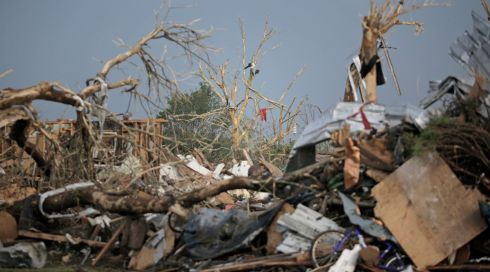 The wreckage of nature and humanity. Photograph:  Brett Deering/Getty Images